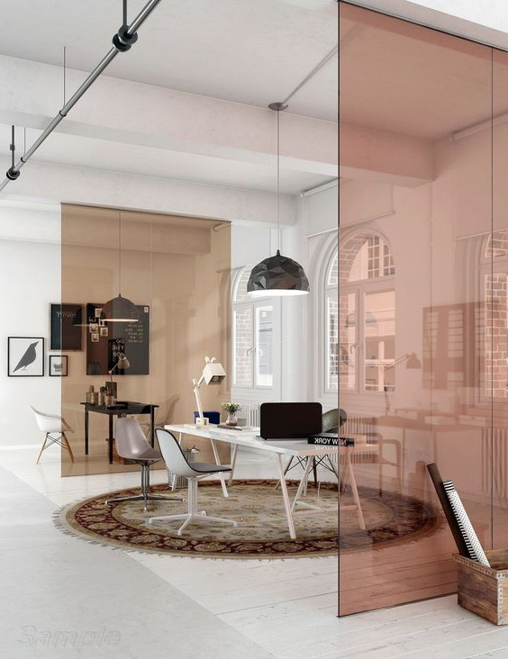 Glass partitions without doors in an office space