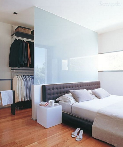 Glass partition separates the wardrobe from sleeping space