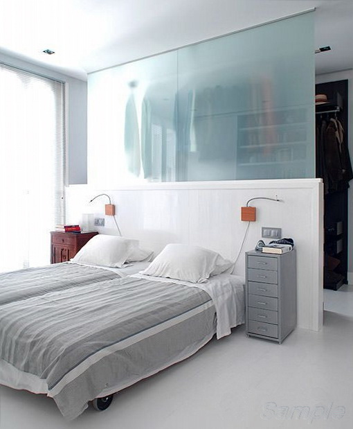 Glass partitions can be used to separate the sleeping area and wardrobe
