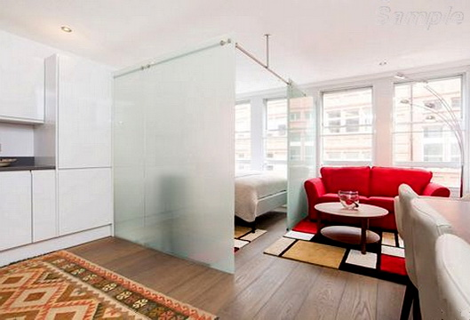 Glass partitions in a studio apartment
