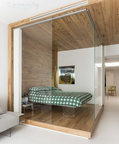 Glass partitions separate the sleeping area from other functional areas of the apartment