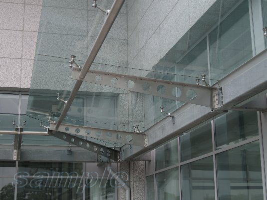 Composite glass canopy on metal сantilever