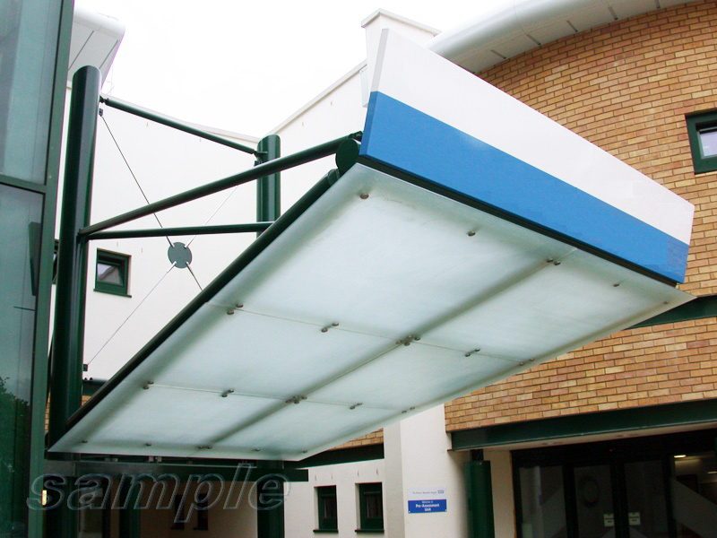 Mounting of composite frosted glass canopy onto cantilever metal structure
