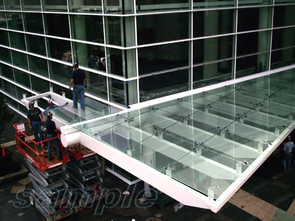 Installation of glass canopy on frame cantilever metal structure