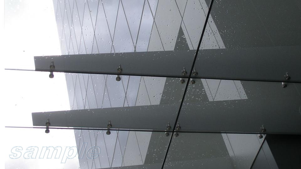 Element of glass canopy on cantilever metal structure