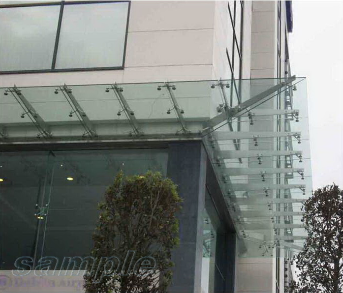 Composite glass canopy on metal cantilevers