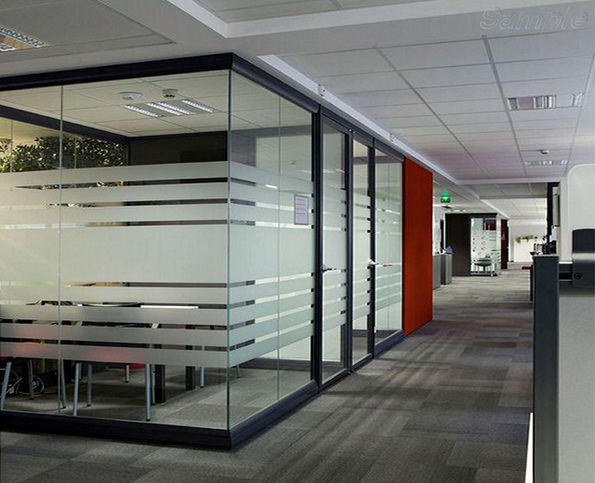 Glass office partitions with a swing door in an aluminum frame