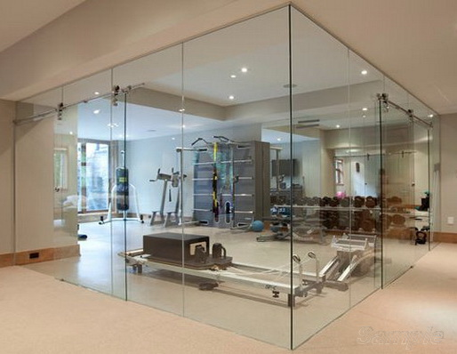Glass office partitions with a sliding door can be used to equip a sports hall