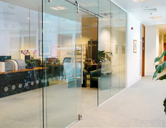 Glass partitions with a sliding door in an office space